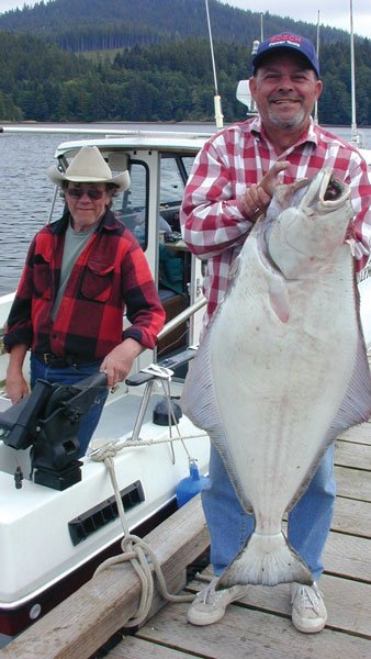 Photo of Jerry and Paul, who is holding a large halibut