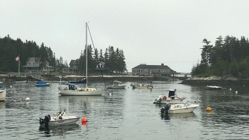 Five Islands Harbor, Georgetown, with Artemis and other moored vessels.