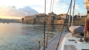 Photo of sailboat arriving in the historic port of Malta