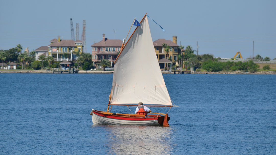 Photo accompanying Building a Boat showing a glued lapstrake sailboat on the water