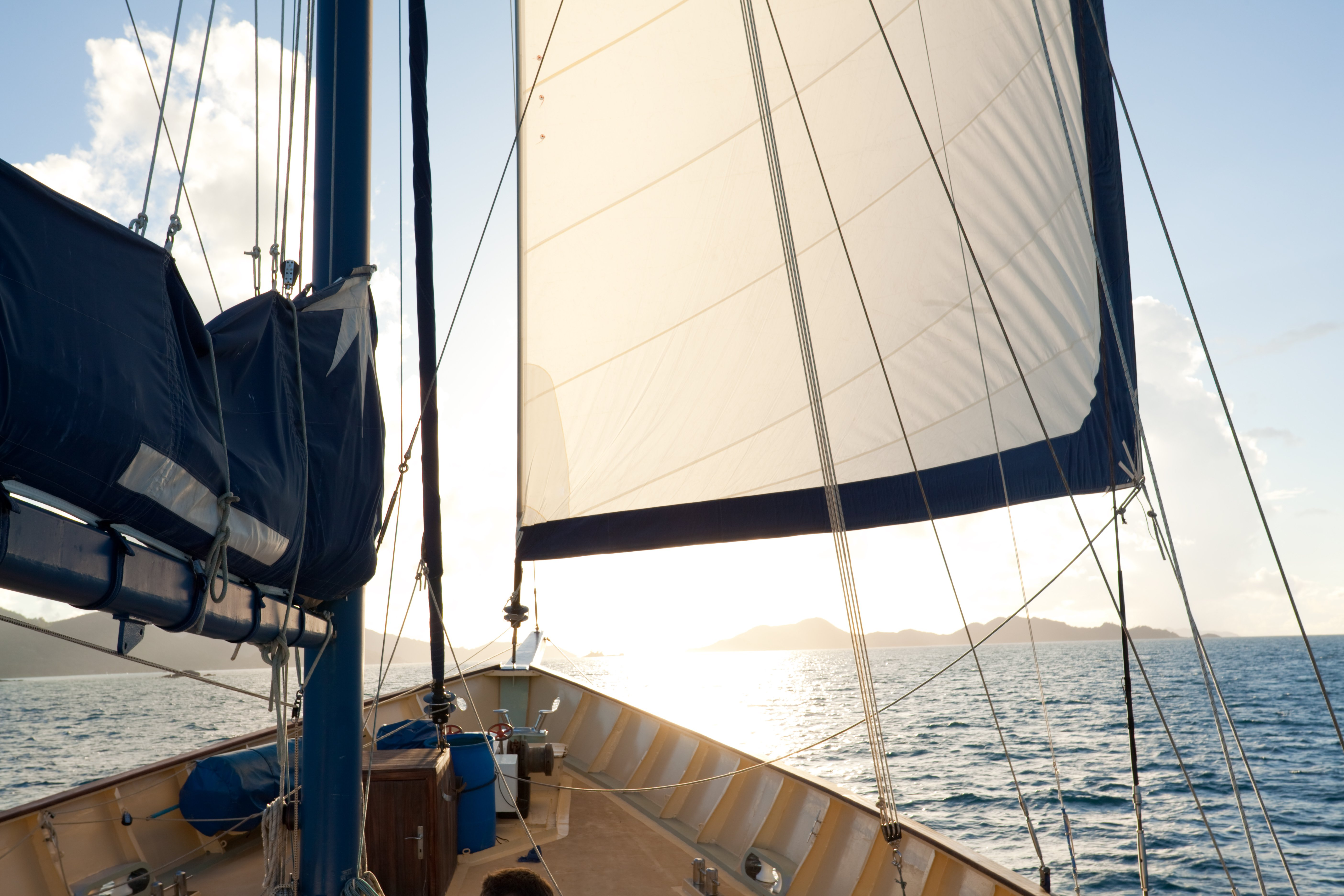 sailing against sun between two islands