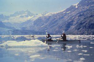 Anita and Sally paddle near Johns Hopkins Glacier