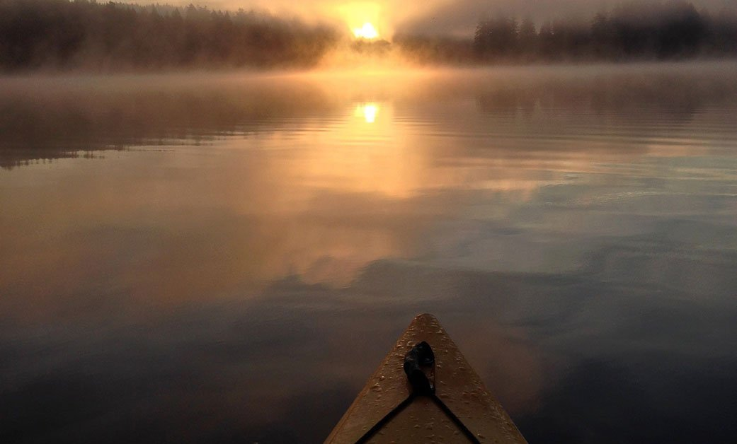 Solo kayak trip at the lake near his home in Camas, Washington, by Shane Hansen